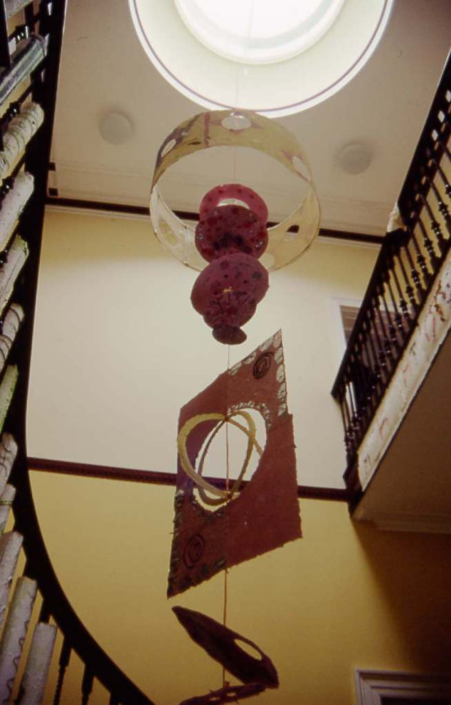 Recycled paper installation in hall stairwell